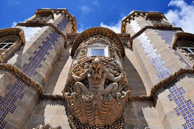 Triton sculpture, Detail of the window in Pena Palace, Sintra - Portugal