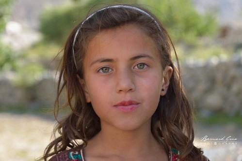 Wakhi: Passu, Sabeen, one of Mr. Berham Baig's daughter, with stunning green eyes. She was already a little actor for a Pakistani TV movie. © Bernard Grua