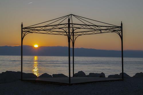 sea morning sunrise beach hills yellow rocks močeniška draga croatia holiday