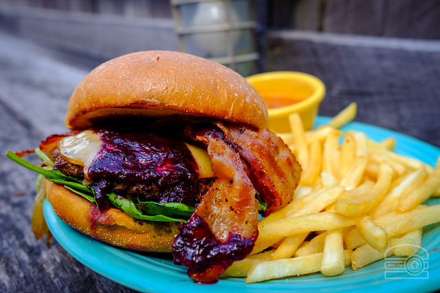 Burger w/ hash brown, gouda, bacon, caramelized onions, spinach,and blueberry BBQ sauce - Black Bear Burritos Evansdale