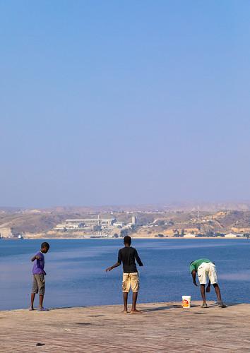 Men fishing on the jetty, Benguela Province, Lobito, Angola | by Eric Lafforgue