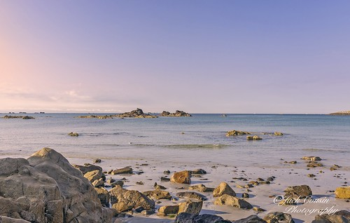 jersey channelislands uk fortd'auvergne rock rocks seascape sea coast seashore shore horizon sky outcrop maritime beach sand pebbles tide lowtide ebbtide waterfront water waterchannel earlymorning morninglight sunlight sunrise pools waterpool tranquil tranquility peaceful serene beauty outdoors nature clearsky bluesky headland promontory bay inlet sthelierbeach nikond610 on1photos
