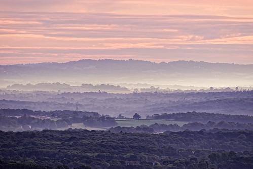 dawn morning sunrise daybreak mist fog trees hills sky clouds telephoto distance view vista