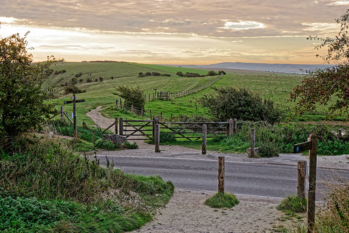 footpath pathway sign road crossing hills nationalpark nationaltrust tree grass cloud sky bollards gate latch rock ghe