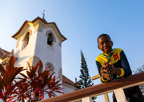 Angolan boy in front of igreja da arrábida, Benguela Province, Lobito, Angola | by Eric Lafforgue