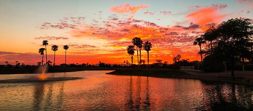 panorama lake water fountain sunset sundown palms arizona oakwood sunlakes iphone clouds sun red