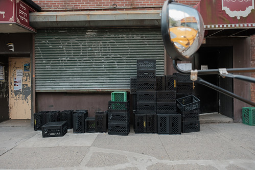 Simply a Collection of Milk Crates on the Sidewalk