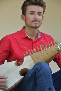Tahir Hussain, from Chapursan,  playing rubab © Bernard Grua