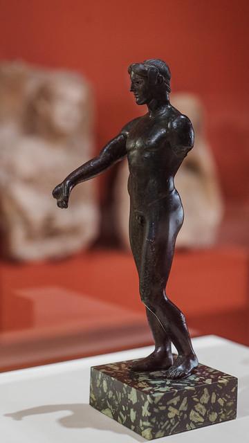 Greek cast bronze statuette of a young male, perhaps Apollo