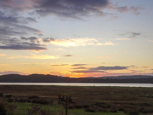uk unitedkingdom britain argyll kintyre clouds green grass sea loch sealoch westlochtarbert sunset gb scotland