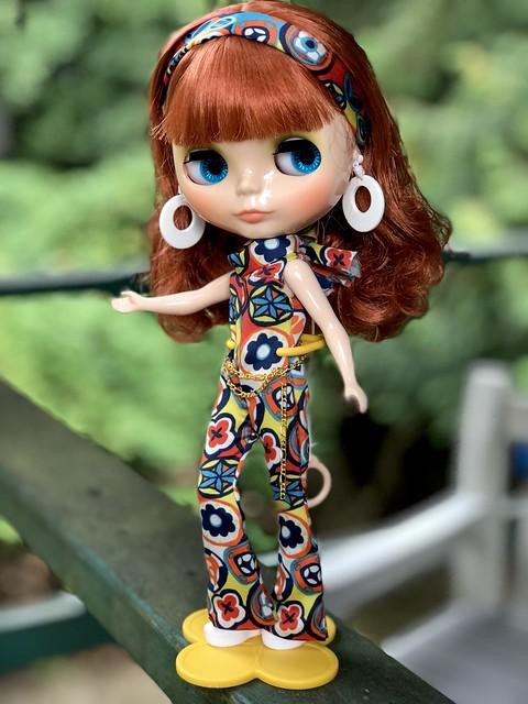 """Doo-ait-n-doo-doo, feelin' groovy"". SarahShades is ""looking for fun and feelin' groovy."" ""Life, I love you..All is groovy"" 59th st Bridge song by Simon&Garfunkel. Psychedelic satin jumpsuit: Painterslife."