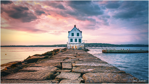 rockland maine breakwater lighthouse rocklandbreakwaterlighthouse clouds stormy sky water ocean sea bay rocky leadinglines sunrise sunset goldenhour vignette dock boating navigation