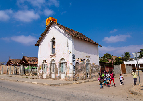 Children walking in front of an old portuguese colonial house, Benguela Province, Catumbela, Angola | by Eric Lafforgue