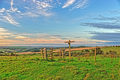 view vista panorama sky cloud grass signpost sign gate fence field posts horizon wire sussex uk footpath pathway