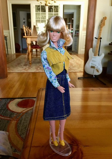 I love the jean skirt - I had a number of them just like it back in the early 1980's.  :>)