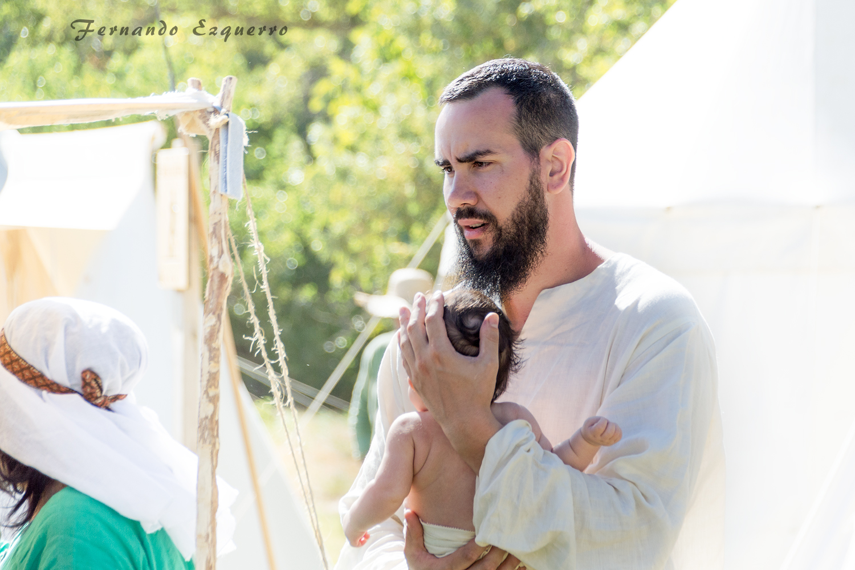 Ceremonia del bautizo del primigénito de un señor que parte a la guerra