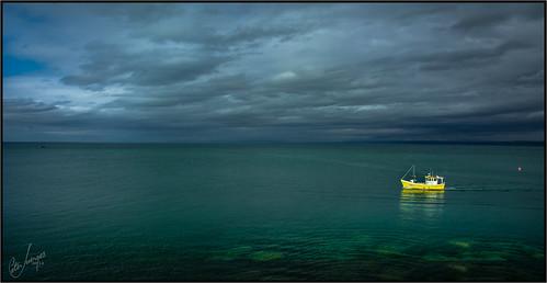 horizon ships greensea dark coast trawlerfishing boats weather seascape sea