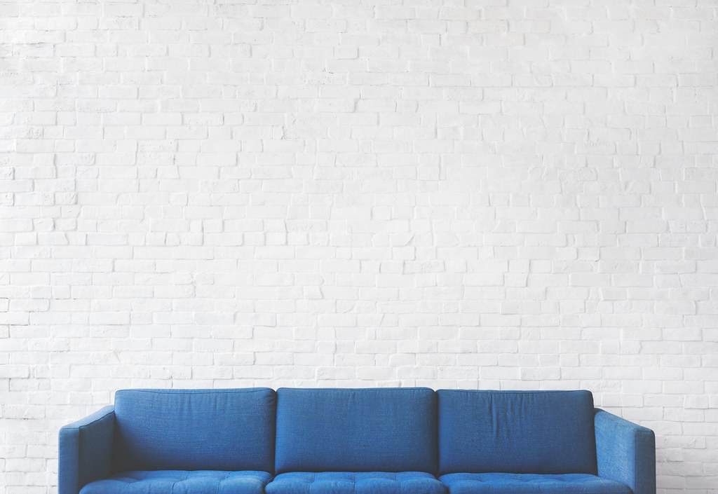 Blue brick wall chair - Credit to https://homegets.com/