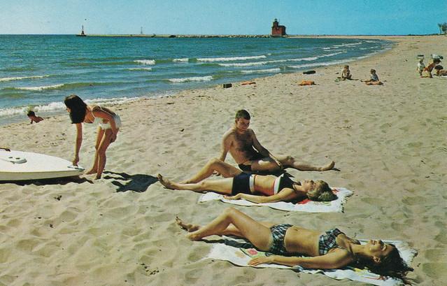 SW Holland Macatawa MI 1960s MACATAWA INN beautiful BEACH BABES and Family FUN Swim & Sail FUN with the USCG BIG RED Lighthouse in view  Lake Michigan South Macatawa Park Beach1