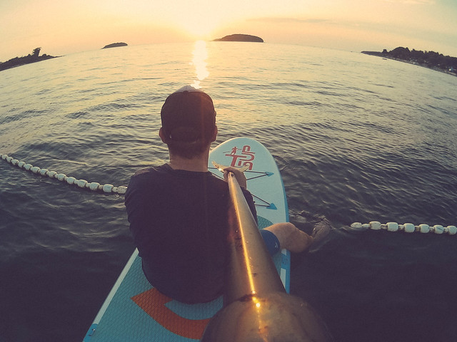 Man watching the sunset on a paddleboard