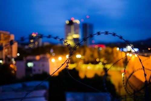 tirana albania pyramid bluelight bluehour sunset travel fence dof bokeh bokehlicious citylights urbex urban city cityscape abandoned