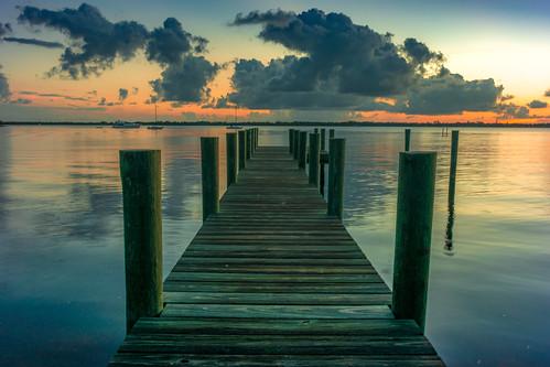 florida usa manatee river dawn sunrise morning water sky pier wood reflection reflect cloud clouds sun