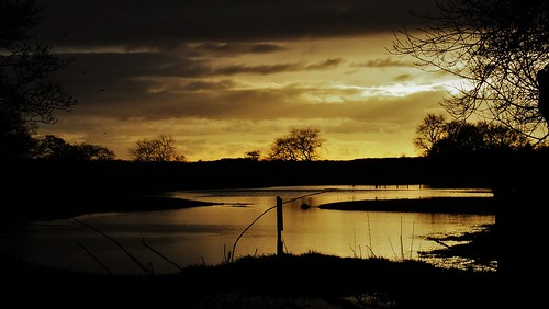 golden skies dark dusk flooded feild sunset bramhope west yorkshire