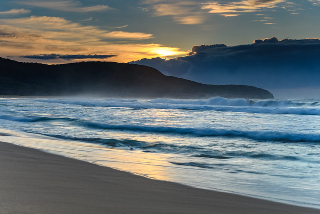 Sunrise Seascape with Headland and Clouds