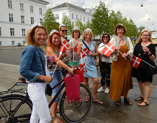Ladies celebrating the 50th birthday of the Crown Prince waving red Danish flags and crowns upon their heads (Copenhagen, Denmark)