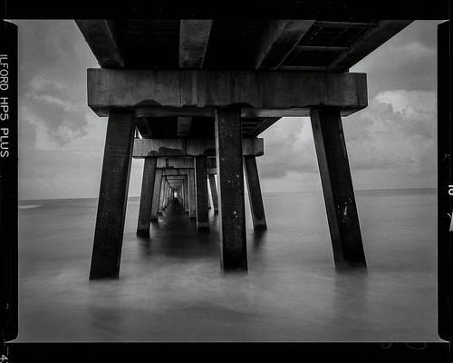beach sunrise waves pier fishing gulf state park florida coast black white bronica etrs hp5 longexposure