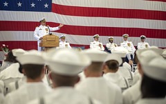 Capt. Rich LeBron, the newly appointed commanding officer of USS Bonhomme Richard (LHD 6), addresses the attendees of a change of command ceremony held in the ship's hangar bay. (U.S. Navy/MC1 Diana Quinlan)