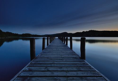 moody blue hour dusk vanishing point parkamoor jetty coniston riggwood wooden posts wood boardwalk eastshore lake cumbria lakedistrict lakeland thelakes lakedistrictnationalpark nationaltrust fell fells cumbrian northwestengland mountains landscape imagestwiston district national park conistone countryside mountain water evening summer englishlakedistrict lakes thelakedistrict ultrawide wideangle wide angle tranquil serene serenity unesco worldheritagesite le longexposure nisi gnd grad 6stopnd twilight
