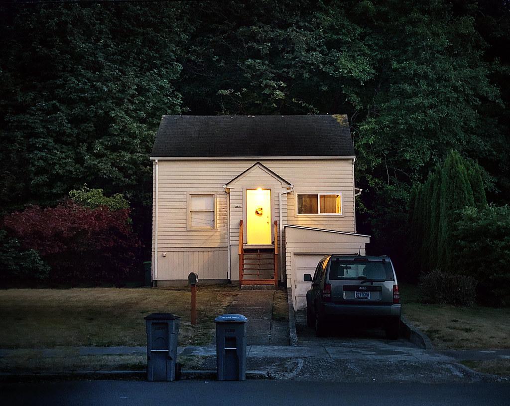 neighborhood house at dusk