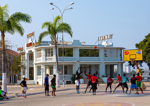 Angolan men playing basket ball in front of the old portuguese colonial tamariz casino, Benguela Province, Lobito, Angola | by Eric Lafforgue