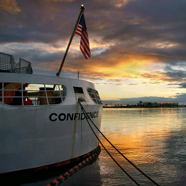 U.S. Coast Guard Cutter Confidence at sunset.