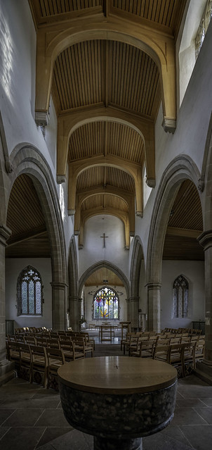 Looking East towards the Alter and stained glass window.
