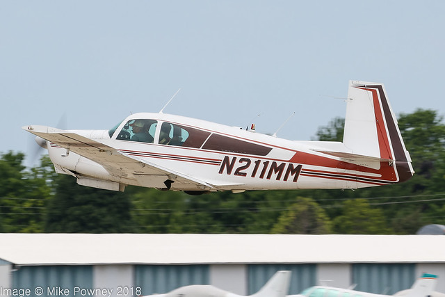 N211MM - 1961 build Mooney M.20C Mark 21, departing from Runway 27 at Oshkosh during Airventure 2018