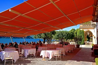 Only the museum villas of lake Como could possibly beat Villa d'Este, Como's priciest hotel accommodations. Unlike Villa d'Este, they offer no full board, no amenities of a high end beach resort. Early morning outside the restaurant. Before season opens.