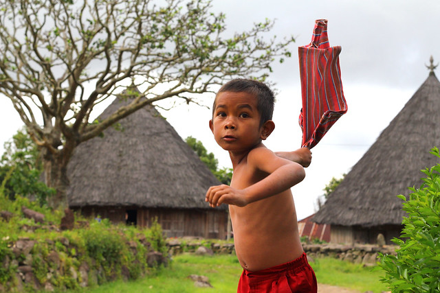 Boy in front of Traditional Houses in Ruteng, Manggarai