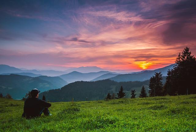 Man watching beautiful sunset