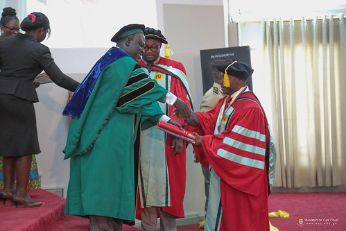 A PhD graduand being decorated.