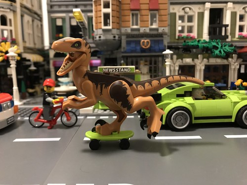 There's a Velociraptor on the rampage in Studsburg riding a skateboard!?!? maybe those crazy scientists created a Velociroller? | by GJBricks