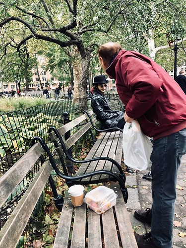 Friendly neighbors chat in Washington Square Park