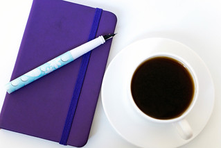 High Angle View Of The Coffee and Notebook With Pen | by wuestenigel