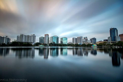 cloud clouds cloudheaven cloudporn longexposurejunkies longexposurephotography skyglory skyline cityscape citypark citylimits orlando florida urbanpark lakeeola lake water reflection waterreflection buildings architecture canon landscapephotographer landscapephoto sky city tree park people skyscraper building boat