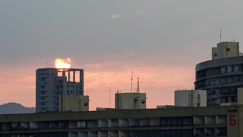 Time Lapse of Sunset behind Apartment Tower and the Guomao Community in Kaohsiung