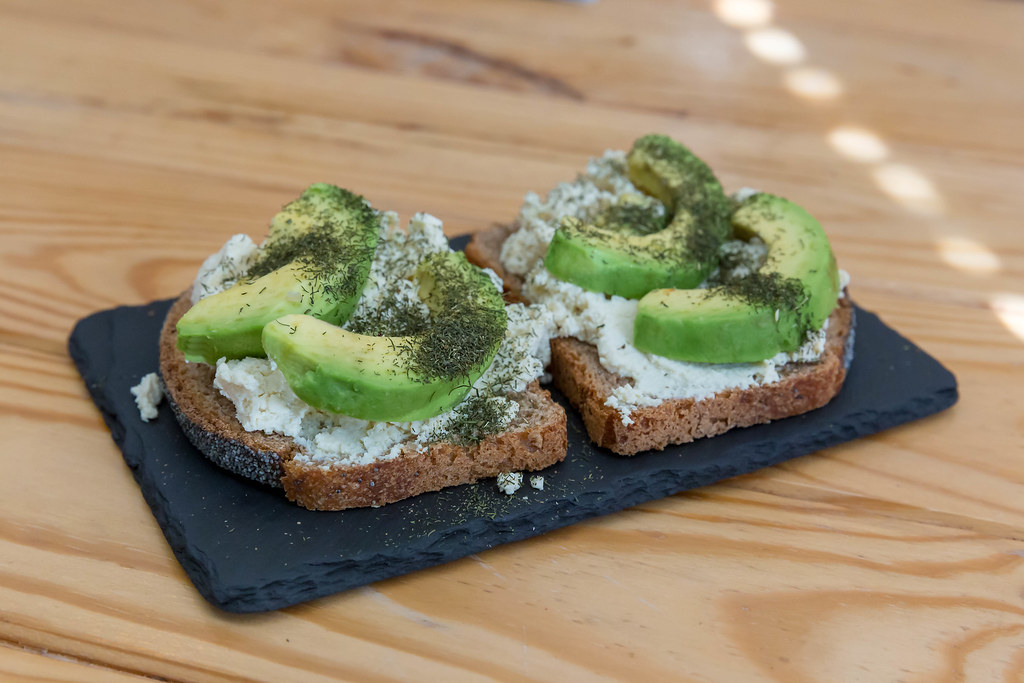 Toast with ricotta, dill and avocado served on stone servi…   Flickr