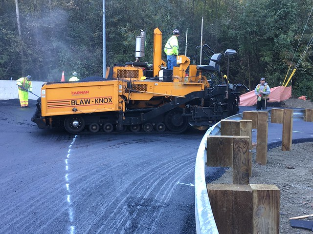 Crews lay new asphalt around new roundabout at Locust Way