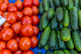 Tomatos and cucumbers on marketplace | by wuestenigel