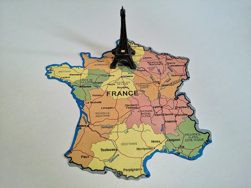 Eiffel Tower Figurine on Paris Map | A small figurine of the ...